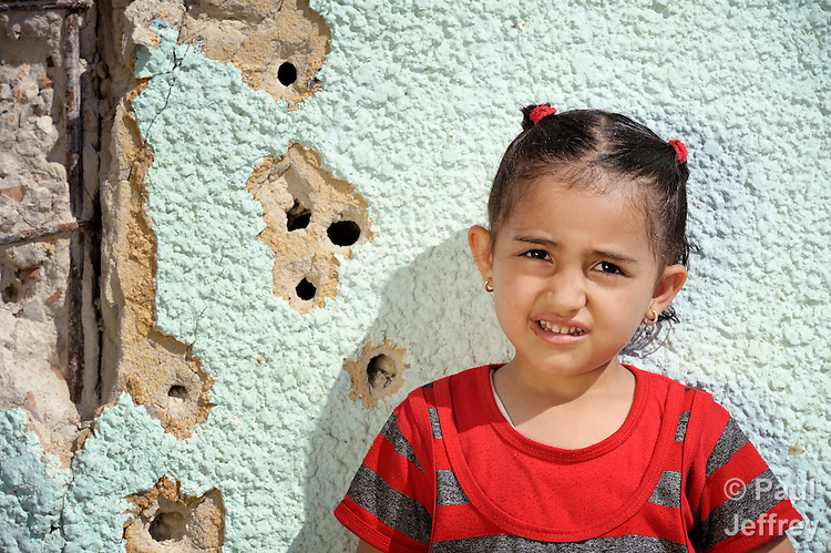 A girl in Misrata, Libya, which has been torn by months of war between rebels and troops loyal to strongman Moammar Gadhafi.