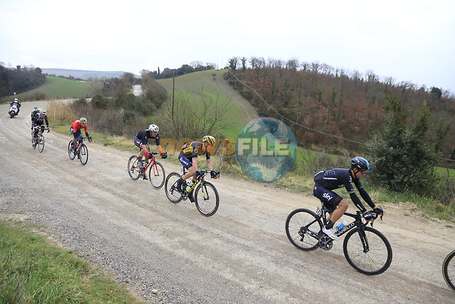 Group two including Michal Kwaitkowski (POL) Team Sky on gravel sector 6 Pieve a Salti during the 2017 Strade Bianche running 175km from Siena to Siena, Tuscany, Italy 4th March 2017.<br /> Picture: Eoin Clarke | Newsfile<br /> <br /> <br /> All photos usage must carry mandatory copyright credit (&copy; Newsfile | Eoin Clarke)