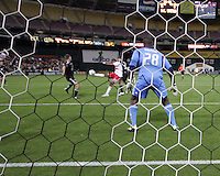 Bill Hamid (28) of D.C. United watches as Juan Agudelo (17) of the New York Red Bulls winds up the shot for the fourth goal during an MLS match at RFK Stadium, in Washington D.C. on April 21 2011. Red Bulls won 4-0.