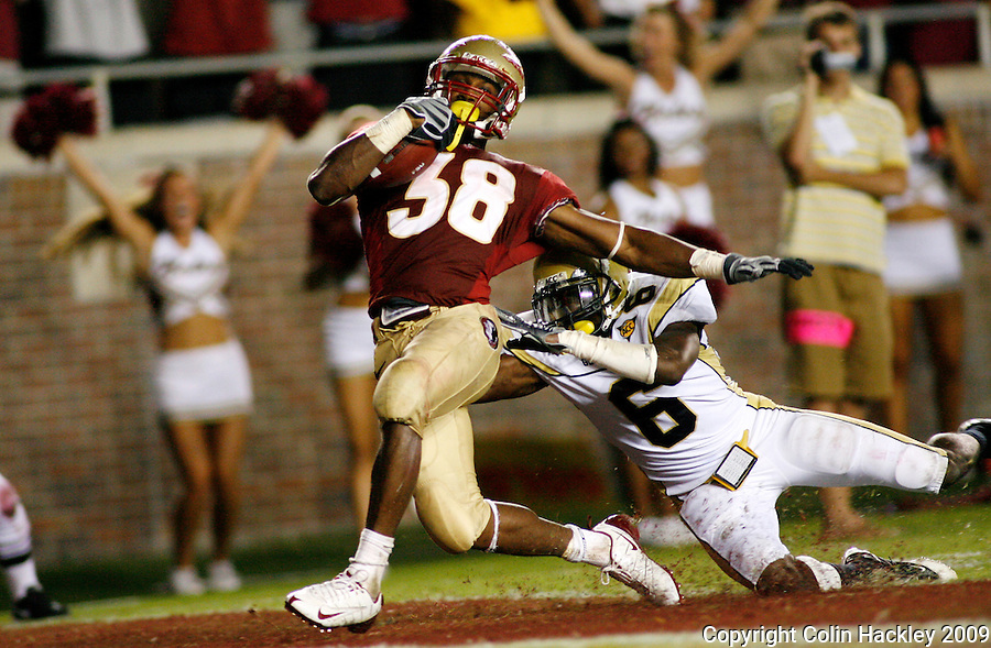 TALLAHASSEE, FL 10/10/09-FSU-Ga. Tech FB09 CH33-Florida State's Jermaine Thomas 32-yard run and touchdown, defended by Georgia Tech's Rod Sweeting was called back because of a Seminole holding penalty during second quarter action, Saturday at Doak Campbell Stadium in Tallahassee. .COLIN HACKLEY PHOTO