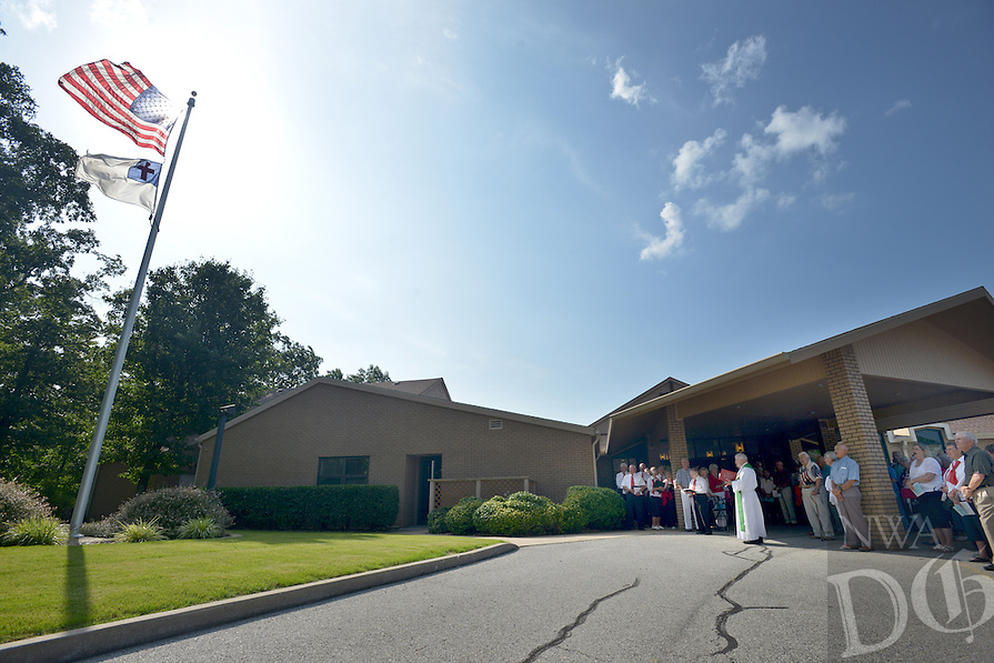 NWA Democrat-Gazette/BEN GOFF &bull; @NWABENGOFF<br /> The congregation of United Lutheran Church in Bella Vista gathers at the flagpole for a 4th of July program on Sunday July 5, 2015.