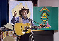 NWA Democrat-Gazette/BEN GOFF @NWABENGOFF<br /> Martin Beggs of Sydney, Australia sings aboout his home country Monday, Feb. 13, 2017, during a presentation at R.E. Baker Elementary in Bentonville. Husband and wife Martin and Nellie Beggs have been presenting their 'Australian Kaleidoscope' program at schools in the United States for over ten years for the Kansas City, Mo. company 'The Cultural Kaleidoscope'. Students joined in songs and Aboriginal dances as they learned about the natural and cultural history of 'The Land Down Under' in assemblies and classes throughout the day.