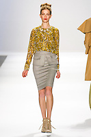 Marlena Szoka walks the runway in a Luca Luca Fall 2011 outfit, designed by Raul Melgoza, during Mercedez-Benz Fashion Week, February 10, 2011