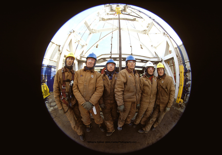 Oil field roughnecks working an onshore rig at Tengiz, Kazakhstan.