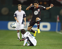 Cristian Castilo #12 of D.C. United leaps over Sainey Nyassi #14 of the New England Revolution during an MLS match on April 3 2010, at RFK Stadium in Washington D.C.