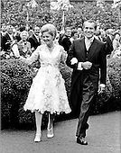 Washington, D.C. - June 12, 1971 -- United States President Richard m. Nixon and first lady Pat Nixon leave the Rose Garden of the White House in Washington, D.C. on Saturday, June 12, 1971 following the marriage ceremony of their daughter, Tricia, to Edward Cox.  More than 400 guests attended the glittering affair..Credit: Bill Allen / CNP