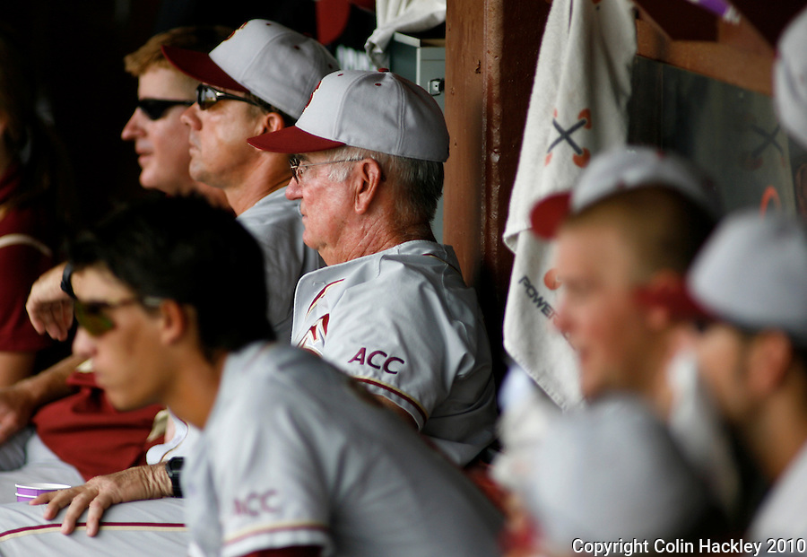 TALLAHASSEE, FL 6/12/10-FSU-VANDY BASE10 CH-Florida State's Mike Martin, Head Coach, monitors the Vanderbilt game from the dug out Saturday during NCAA Super Regional action at Dick Howser Stadium in Tallahassee. The Commodores beat the Seminoles 6-2 to stay alive for game three...COLIN HACKLEY PHOTO