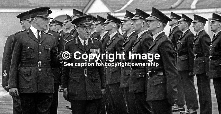 RUC recruits passing out from the RUC training depot in Enniskillen, Co Fermanagh, N Ireland, are inspected by Graham Shillington, the deputy inspector general. Extreme left is John Hermon, later Sir John Hermon and a Chief Constable of the RUC. 29th January 1970. 197001290061b<br />