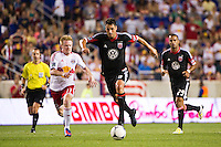 Branko Boskovic (8) of DC United is chased by Dax McCarty (11) of the New York Red Bulls. The New York Red Bulls defeated DC United 3-2 during a Major League Soccer (MLS) match at Red Bull Arena in Harrison, NJ, on June 24, 2012.