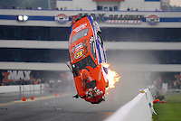 Sept. 16, 2012; Concord, NC, USA: NHRA pro stock driver Shane Gray goes airborne on fire as he crashes during qualifying for the O'Reilly Auto Parts Nationals at zMax Dragway. Gray would be uninjured. Mandatory Credit: Mark J. Rebilas-