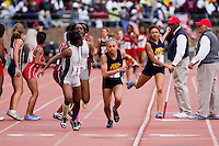 After receiving the baton from Jada Steward, Michelle Davis runs anchor for West Catholic in the High School Girls' 4x400 Philadelphia Area at the Penn Relays on April 24. West Catholic won the race in 3:48.48.