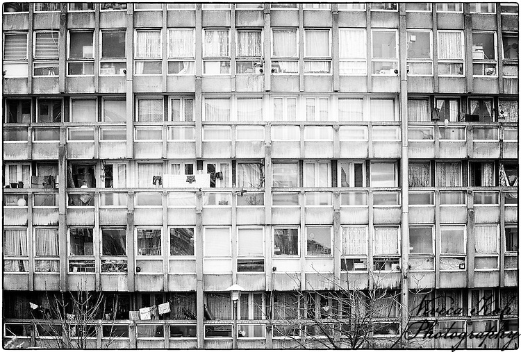 Robin Hood Gardens is a council housing complex in Poplar, London designed in the late 1960s by architects Alison and Peter Smithson and completed in 1972. It was intended as an example of the 'streets in the sky' concept: social housing characterised by broad aerial walkways in long concrete blocks, much like the Park Hill estate in Sheffield; it was both informed by, and a reaction against, Le Corbusier's Unit&eacute; d'Habitation.<br />