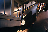 Muslim women enter the platform of London's East Ham metro station platform..Picture taken 2005 by Justin Jin