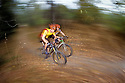 CC98160-00...WASHINGTON - Mountain bikers in the Cascade foothills. (MR-yes)