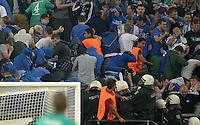 FUSSBALL   CHAMPIONS LEAGUE   SAISON 2013/2014   PLAY-OFF FC Schalke 04 - Paok Saloniki        21.08.2013 Polizisten stuermen waehrend des Spiels den Schalke Fan Block und setzen massiv Pfefferspray ein.
