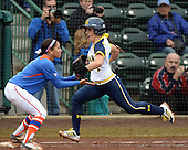 Michigan Wolverines infielder Abby Ramirez (1) beats out a throw on a bunt base hit during the season opener against the Florida Gators on February 8, 2014 at the USF Softball Stadium in Tampa, Florida.  Florida defeated Michigan 9-4 in extra innings.  (Copyright Mike Janes Photography)