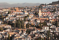 Church of San Nicolas (right), originally built in the 16th century in Mudejar style but rebuilt 1932 after a fire, and El Albayzin, the medieval Moorish old town of Granada, seen from the Alhambra Palace, Granada, Andalusia, Southern Spain. From the 8th to the 15th centuries, Granada was under muslim rule and retains a distinctive Moorish heritage. Granada was listed as a UNESCO World Heritage Site in 1984. Picture by Manuel Cohen