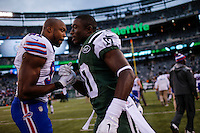 New York Jets, WR, T.J. Graham greets Buffalo Bills, DE, Manny Lawson, at the end of their NFL game at MetLife Stadium in New Jersey. 09.05.2014. VIEWpress