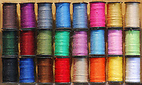 USA, Spools of sewing thread in different colors.