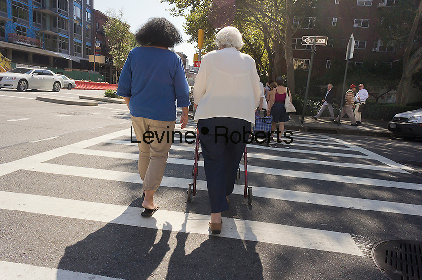 Elderly women cross the street in the New York neighborhood of Chelsea on Friday, September 14, 2012. (© Richard B. Levine)