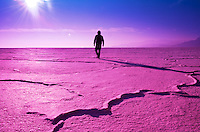 color at the bonneville salt flats, an walking in the distance