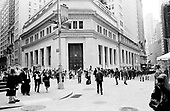 New York, New York<br /> USA<br /> May 2010<br /> <br /> Wall Street traders, investment bankers, musicians, preachers, policemen, security guards, military personal and tourists all make Wall Street and the New York Stock exchange an ever changing three-ring circus were the world of finance and trade come together within a few blocks.