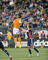 Houston Dynamo midfielder Giles Barnes (23) leaps for a head ball with New England Revolution defender A.J. Soares (5) behind.  The New England Revolution played to a 1-1 draw against the Houston Dynamo during a Major League Soccer (MLS) match at Gillette Stadium in Foxborough, MA on September 28, 2013.