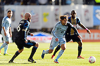 Graham Zusi (8) of Sporting Kansas City is marked by Conor Casey (6) of the Philadelphia Union during a Major League Soccer (MLS) match at PPL Park in Chester, PA, on October 26, 2013.