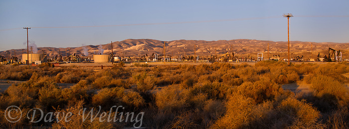 906500008 panorama oil derricks and storage tanks in a working oil field in southern kern county california