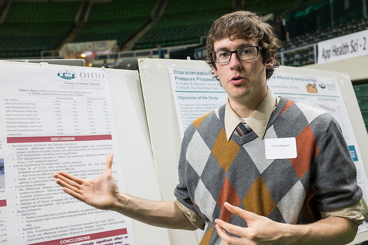 Ohio University graduate student Trevor Magnotti explains his research on the posture of marching band participants during the 2015 Ohio University Research and Creative Activity Expo on Thursday, April 10, 2015.  Photo by Ohio University / Rob Hardin