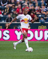 Thierry Henry (14) of the New York Red Bulls brings the ball upfield during the game at PPL Park in Chester, PA.  New York defeated Philadelphia, 3-0.