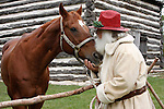 Western cowboy Santa spending time with his trusty steed