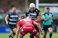 Dave Attwood of Bath Rugby takes on the Scarlets defence. Pre-season friendly match, between the Scarlets and Bath Rugby on August 20, 2016 at Eirias Park in Colwyn Bay, Wales. Photo by: Patrick Khachfe / Onside Images