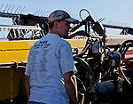 A farmer prepares to conduct maintenance on his Case 8120 combine.