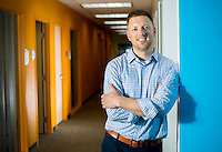 NWA Democrat-Gazette/JASON IVESTER <br /> John Parrish; photographed on Tuesday, July 21, 2015, inside the General Mills office in Rogers for nwprofiles spotlight on Big Brothers Big Sisters of Northwest Arkansas