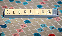 Sterling spelled out in Scrabble Letters.