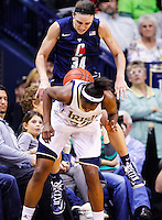SOUTH BEND, IN - MARCH 04: Kelly Faris #34 of the Connecticut Huskies and Jewell Loyd #32 of the Notre Dame Fighting Irish battle for a loose ball at Purcel Pavilion on March 4, 2013 in South Bend, Indiana. (Photo by Michael Hickey/Getty Images) *** Local Caption *** Kelly Faris; Jewell Loyd