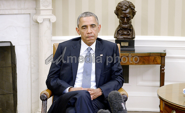 16 July 2015 - Chattanooga,Tennessee - United States President Barack Obama makes a statement in the Oval Office of the White House on the shootings in Chattanooga,Tennessee, that left four Marines dead July 16, 2015 in Washington, D.C. Photo Credit: Olivier Douliery/CNP/AdMedia