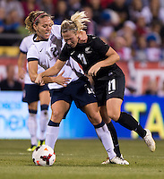 Lauren Holiday (12) of the USWNT fouls Kirsty Yallop (11) of New Zealand during an international friendly at Crew Stadium in Columbus, OH. The USWNT tied New Zealand, 1-1.