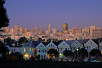 Victorian Homes along Steiner Street with city lights at dusk, San Francisco, California USA