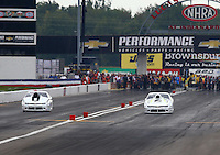Sept. 1, 2014; Clermont, IN, USA; NHRA pro stock driver Shane Gray (left) races alongside Shane Tucker during the US Nationals at Lucas Oil Raceway. Mandatory Credit: Mark J. Rebilas-USA TODAY Sports