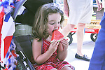 Isle Doorley stays cool with watermelon during Los Altos Hills' annual Fourth of July Parade.