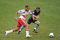 Thierry Henry (14) of the New York Red Bulls is marked by Andrew Tutte (52) of Manchester City F. C.  during a Barclays New York Challenge match at Red Bull Arena in Harrison, NJ, on July 25, 2010.