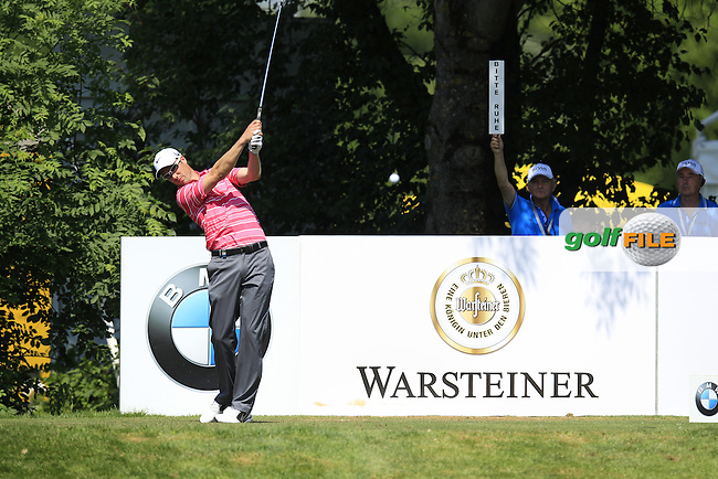 Ross Fisher (ENG) tees off the 4th tee during Thursday's Round 1 of the 2013 BMW International Open held on the Eichenried Golf Club, Munich, Germany. 20th June 2013<br /> (Picture: Eoin Clarke www.golffile.ie)