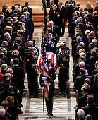 Washington, D.C. - January 2, 2007 -- A military honor guard carry the casket of former President Gerald R. Ford during a State Funeral service at the Washington National Cathedral in Washington  Tuesday, January 2, 2007. Behind the casket, President Bush escorts former first lady Betty Ford.<br /> Credit: Pablo Martinez Monsivais-Pool via CNP