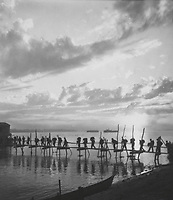 Silhouette of troops at Pandu Ghat.  124th Cavalry Regt., 5332nd Brigade (Prov) on move from Ramgarh Training Center to Myitkyina, Burma.  October 25, 1944.  T5c. Kirsten.  (Army)<br /> NARA FILE #:  111-SC-197483<br /> WAR &amp; CONFLICT BOOK #:  1159