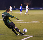 Wildcat keeper Jack Van Arsdale launches the ball downfield during a goal kick during the first half of play.