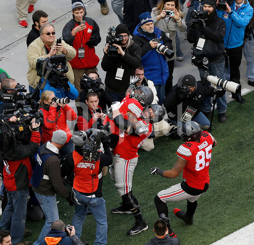 Ohio State Buckeyes running back Curtis Samuel (4) celebrates his game-winning touchdown with Ohio State Buckeyes offensive lineman Pat Elflein (65) during the second overtime of the NCAA football game between the Ohio State Buckeyes and the Michigan Wolverines at Ohio Stadium on Saturday, November 26, 2016. (Columbus Dispatch photo by Jonathan Quilter)