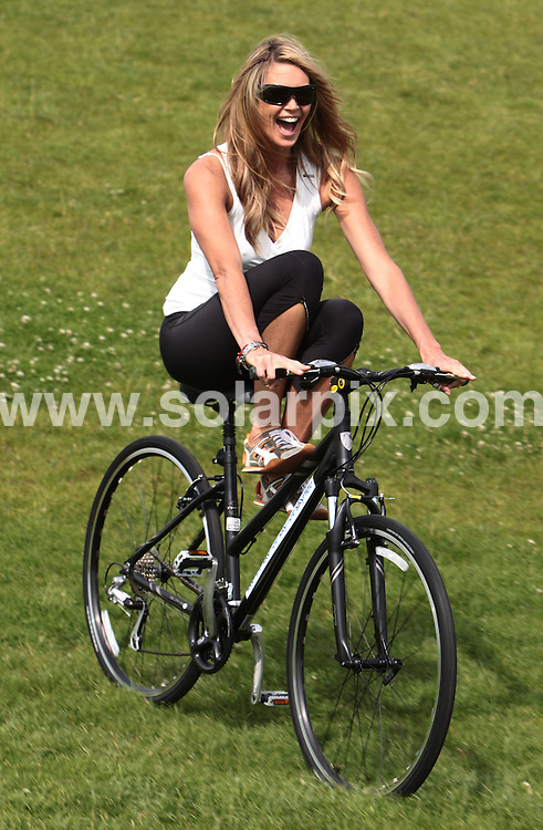 **ALL ROUND PICTURES FROM SOLARPIX.COM**.**NO UK NEWSPAPER PUBLICATION**.**UK MAGAZINE & SUPPLEMENT PUBLICATION ONLY** AND NO PUBLICATION IN AUSTRALIA, FRANCE, GERMANY, ITALY AND SCANDINAVIA** .Model Elle Macpherson, Olympic Gold Medalist  Victoria Pendleton and TV presenter  Gethin Jones today launched Sky's campaign to get people back on their bikes, through a summer of free Skyride cycling events. Regents Park, London, UK. 17 June 2009..This pic: Elle Macpherson..JOB REF: 9261 SFE       DATE: 17_06_2009.**MUST CREDIT SOLARPIX.COM OR DOUBLE FEE WILL BE CHARGED**.**ONLINE USAGE FEE GBP 50.00 PER PICTURE - NOTIFICATION OF USAGE TO PHOTO @ SOLARPIX.COM**.**CALL SOLARPIX : +34 952 811 768 or LOW RATE FROM UK 0844 617 7637**