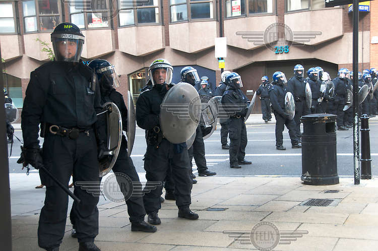 Riot police stand guard on Mare Street in the London borough of Hackney, as they prepare to face rioters. London saw the beginnings of riots on Saturday evening, after a peaceful protest in response to the shooting by police of Mark Duggan during an attempted arrest, escalated into violence. By the third night of violence, rioting had spread to many areas of the capital and to other cities around the country.